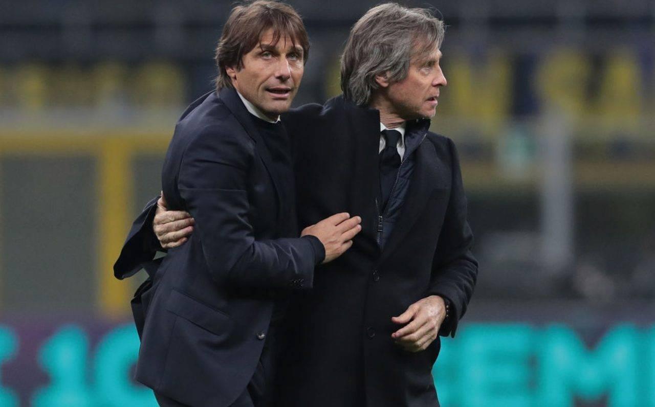 Conte e Oriali si abbracciano