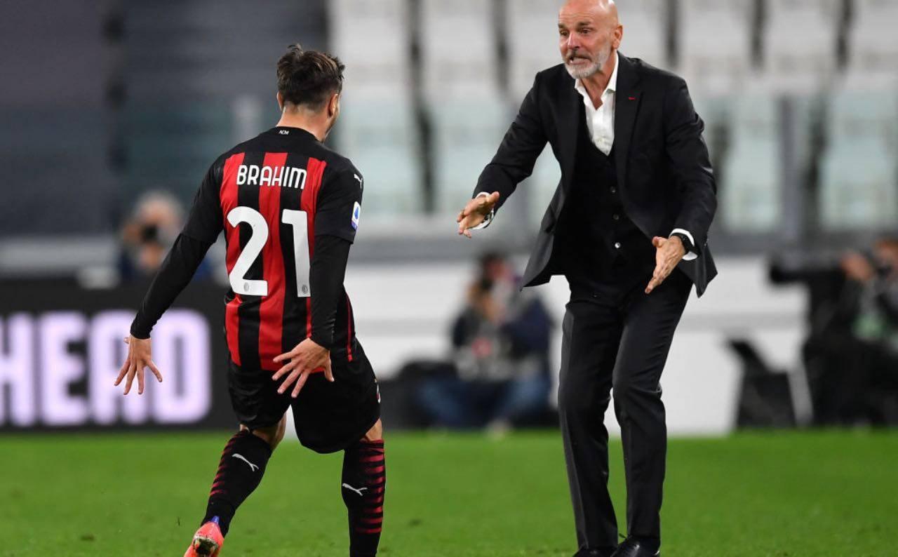 Brahim Diaz esulta con Pioli dopo il gol alla Juventus