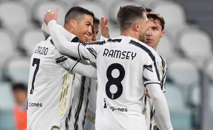 Ronaldo e Ramsey esultano