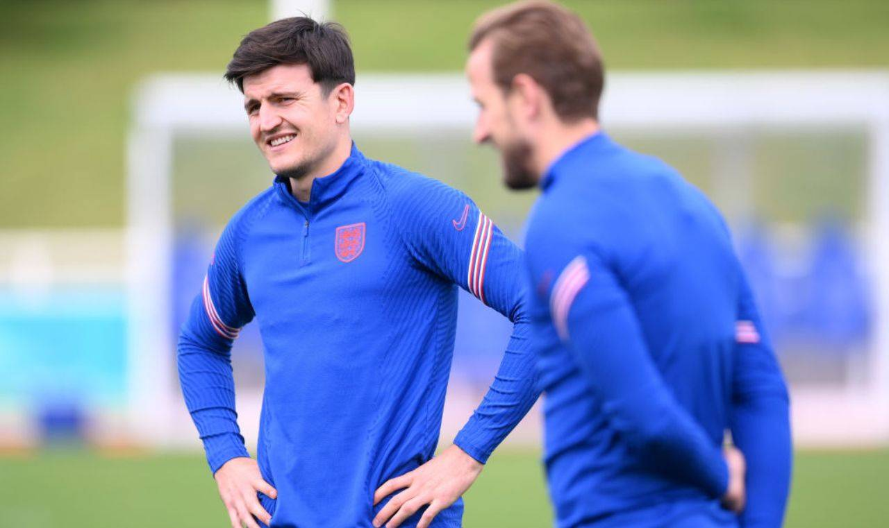 Maguire e Kane sorridono
