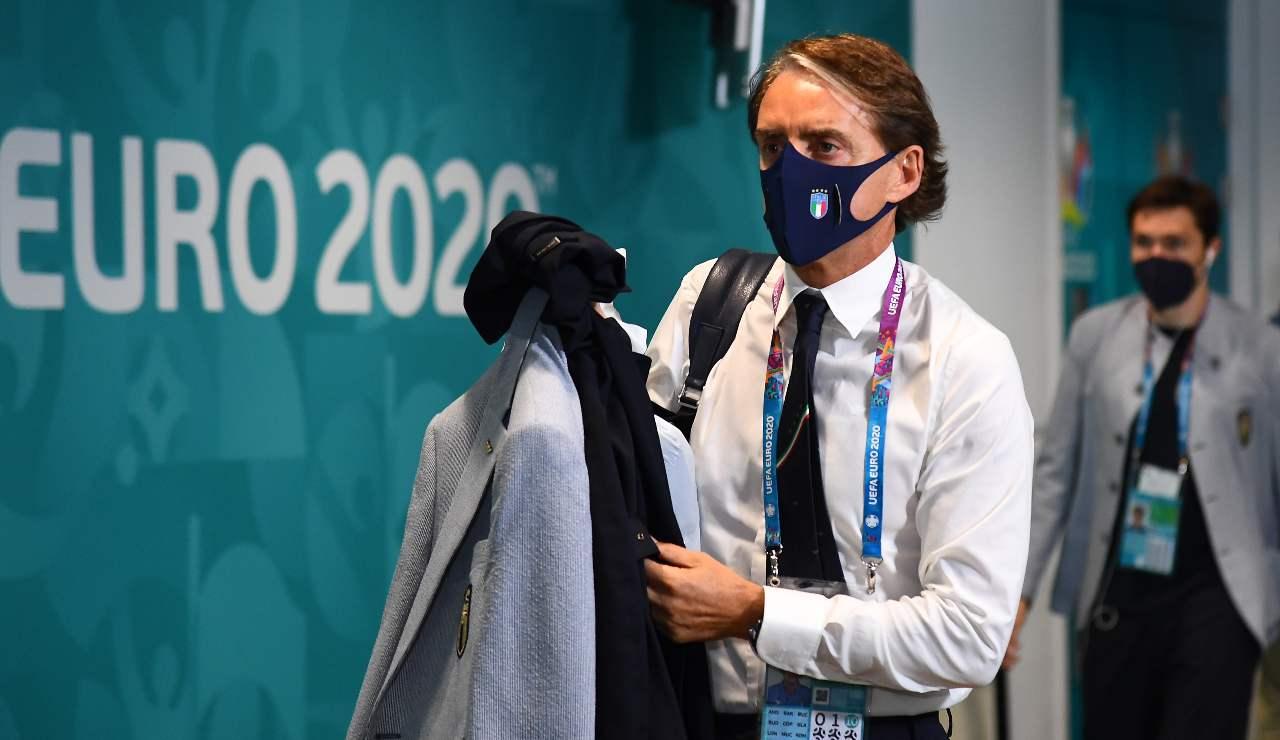 Mancini con mascherina